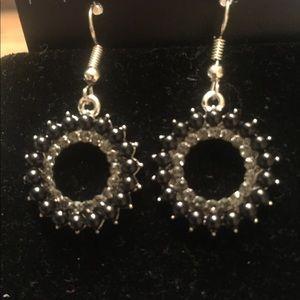 Black hoop earrings with clear rhinestones
